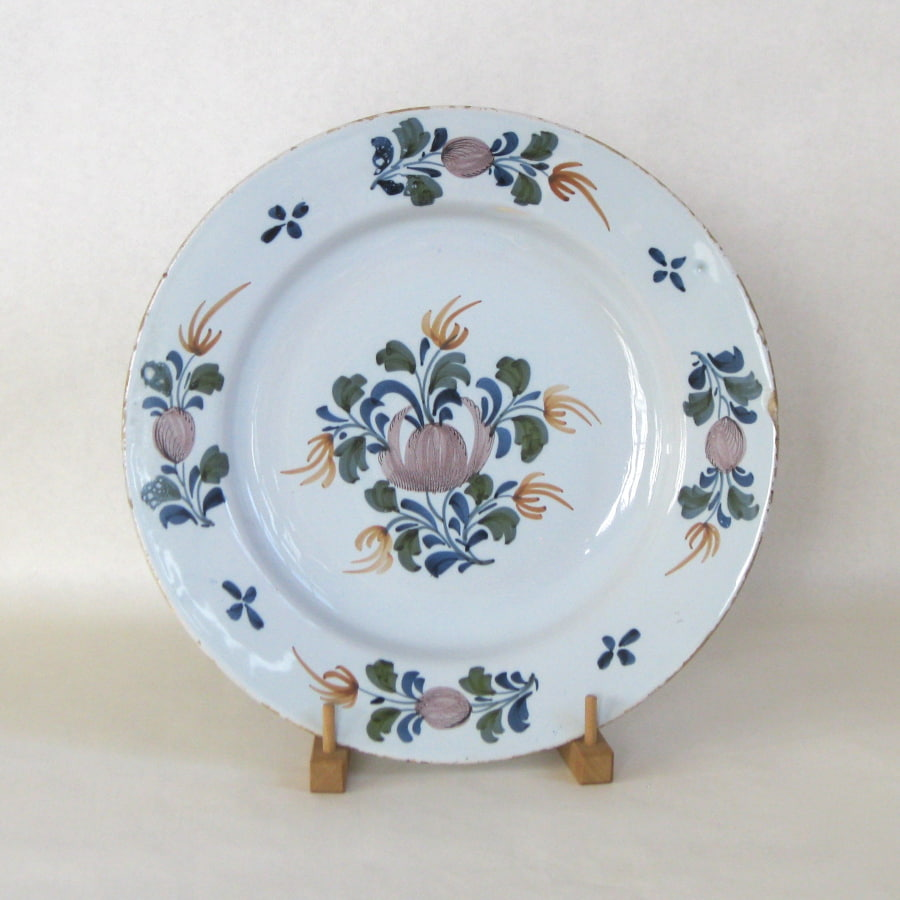 English tin-glazed charger with floral design